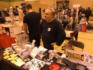 The oft not-photographed Billiam Babble (me, Will) at Loughborough Comic-Con 2017 (Will stands behind stall, looking bemused)